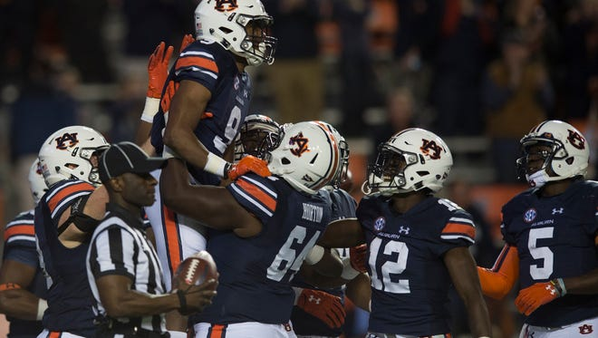 Auburn running back Kam Martin (9) celebrates after scoring a touchdown during the NCAA football game between Auburn and Arkansas Saturday, Oct. 22, 2016, in Auburn, Ala. Auburn defeated Arkansas 56-3.Albert Cesare / Advertiser