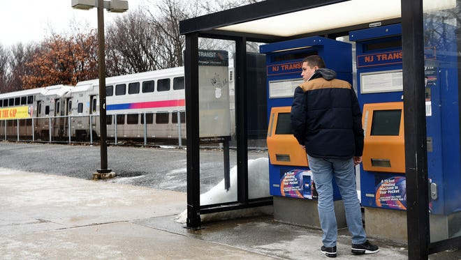 A passenger buys a ticket for an NJ Transit train at the Clifton train on Thursday, January 11,  2018.