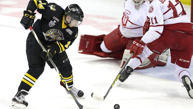 Green Bay Gamblers forward Jason Dhooghe (14) tries to score against the Dubuque Fighting Saints  in a USHL playoff game on April 18 at the Resch Center in Ashwaubenon. Dhooghe is one of seven returning players for the Gamblers this season.