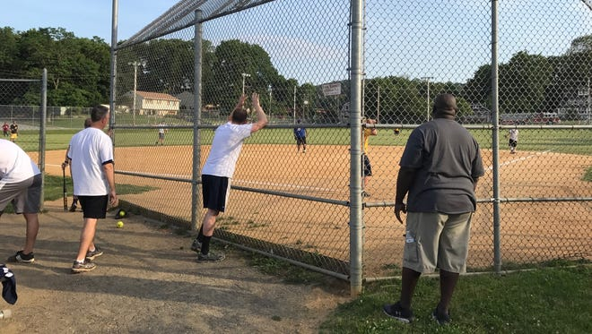 Police from Butler and Bloomingdale played a charity softball game Tuesday to raise money for the family of Matthew Polifonte, who was severely injured when a drunk driver struck the car his mom was driving. Police won the game, 17-2.