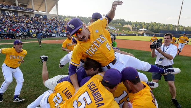 LSU piles up on the field and celebrates after winning the SEC Baseball Tournament championship game 2-0 over Florida, Sunday, May 25, 2014, at the Hoover Met in Hoover, Ala.