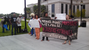Protesters stand outside courthouse following guilty verdict in the murder trial of Michael Dunn.