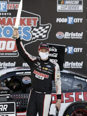Brad Keselowski celebrates after winning last Saturday's NASCAR Cup Series auto race at Bristol Motor Speedway. NASCAR will return to Kansas Speedway from July 23-25 for five races over three days in four different series.