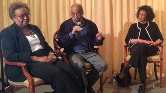 Civil rights veteran and author Charles Cobb tells a story about the civil rights movement to Joyce Ladner (left) while sister Dorie Ladner (right) listens.