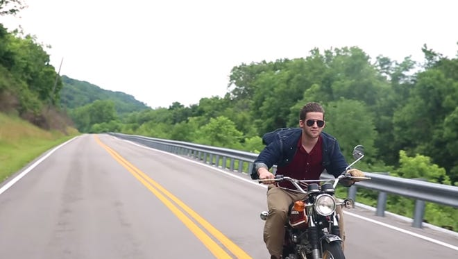 Douglas Gautraud riding what is now his mother's vintage motorcycle.