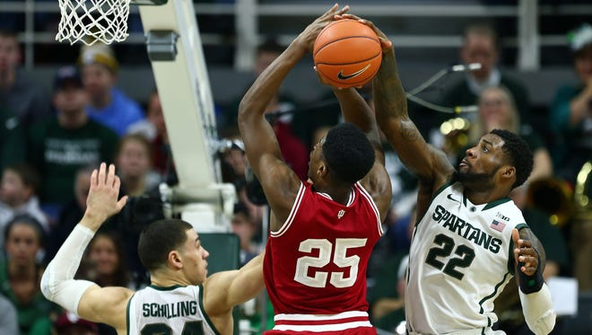 Indiana Hoosiers forward Emmitt Holt has shot blocked by Michigan State Spartans guard/forward Branden Dawson (22) during the 2nd half at Jack Breslin Student Events Center.