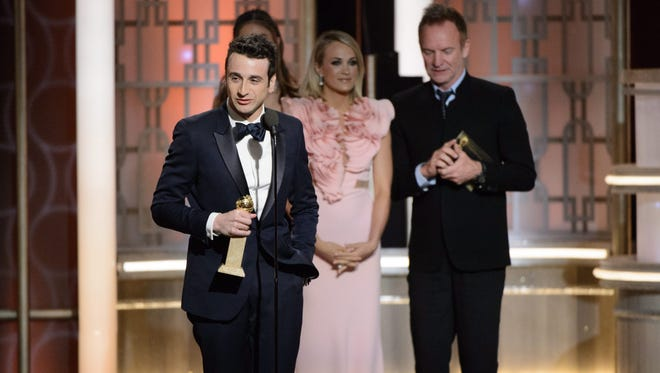 Nicolet High School graduate Justin Hurwitz (left) accepts the Golden Globe Award for Best Original Score - Motion Picture for 'La La Land' during the 74th annual Golden Globe Awards ceremony on Jan. 8.