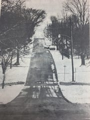 Snow showers on February 17th, 1975 led to icy conditions on rural roads. The county received about an inch of snow, as shown here on East Spalding Street.