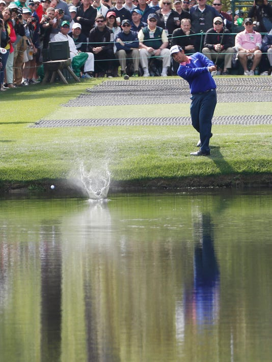 Hideki Matsuyama, of Japan, bounces his golf ball off the water hole on the 16th hole during a practice round for the Masters golf tournament Wednesday, April 6, 2016, in Augusta, Ga. (AP Photo/David J. Phillip)