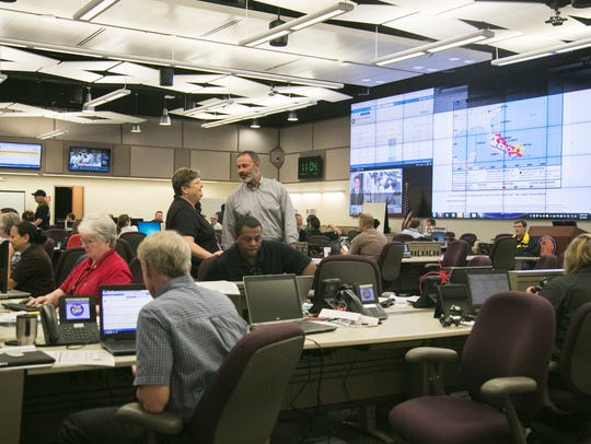 Officials in the Situation Room at the Lee County Emergency