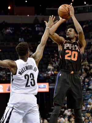 Phoenix Suns forward Josh Jackson (20) shoots against Memphis Grizzlies guard Ben McLemore (23) in the second half of an NBA basketball game Wednesday, Feb. 28, 2018, in Memphis, Tenn.