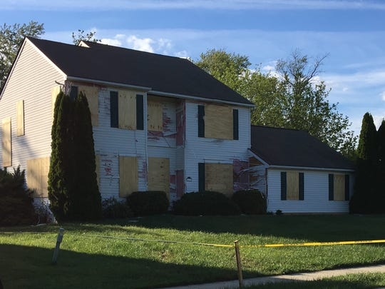 A house on the 500 block of St. Michaels Drive in the Brick Mill Farm development was left in ruins after Burgon Sealy Jr. barricaded himself inside, shooting at police during a 21-hour standoff.