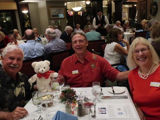 From left, Ed Dixon with Bruce and Marilyn Heinrich.