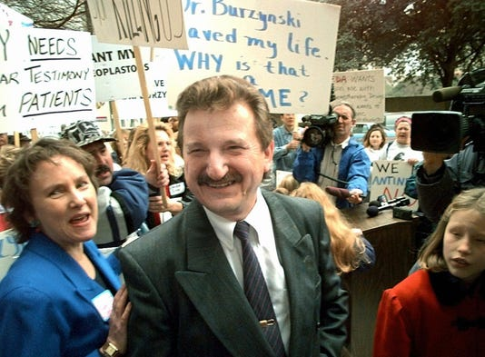 Doctor Stanislaw Burzynski makes his way to the federal courthouse for jury selection in his 1997 criminal trial, as supporters demonstrate outside the courthouse Jan. 6, 1997, in Houston. Burzynski pleaded innocent to a 75-count federal indictment that charged him with mail fraud and violating Food and Drug Administration regulations in the use of antineoplastons, experimental substances he created to treat cancer. One of his criminal trials ended in a hung jury. In the other, he was acquitted.