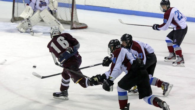 Scarsdale's James Nicholas (16) in the first period Monday against Rye Town/Harrison at Playland Ice Casino.