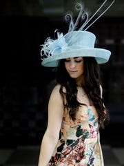 Taylor Teach wears a hat by Jane Ryder Millinery and