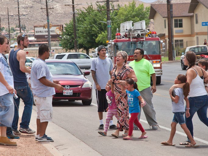 Residents cope with the loss of their homes on 400 East Saturday, July 19, 2014.