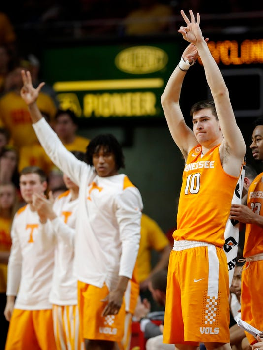 Tennessee forward John Fulkerson, right, celebrates with teammates on the bench during the second half of an NCAA college basketball game against Iowa State, Saturday, Jan. 27, 2018, in Ames, Iowa. (AP Photo/Charlie Neibergall)