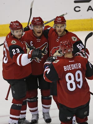 Coyotes' Shane Doan (19), Oliver Ekman-Larsson (23), Mikkel Boedker (89) and Antoine Vermette (50) celebrate Doan's second goal of the game during the third period at Gila River Arena in Glendale, Ariz., on Friday, February 12, 2016. Doan assisted Ekman-Larsson on a goal in the second period which broke the franchise record point total with 930. The Doan goal made the new record 931 career points.