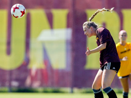 Transfer Jemma Purified heads the ball during an  intrasquad