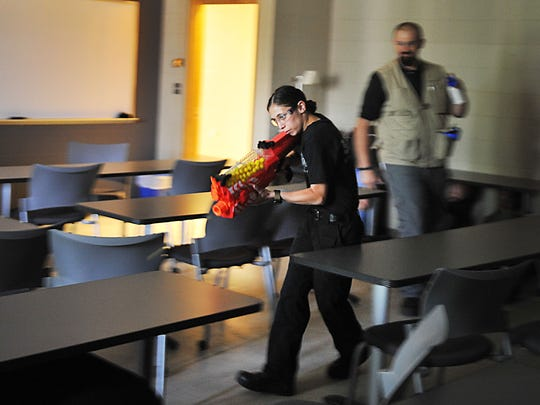 First responders practice ALICE training methods during a hands-on simulation Monday, June 4, at the University of Sioux Falls Salsbury Science Center.