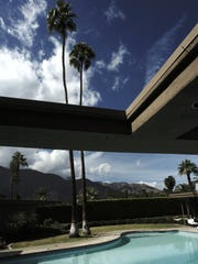 The home of Frank Sinatra with the original two Palms that gave the house its name of Twin Palms.