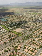 An aerial view looking southwest at housing developments
