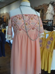 Pastel colors and embroidery, shown on this dress at