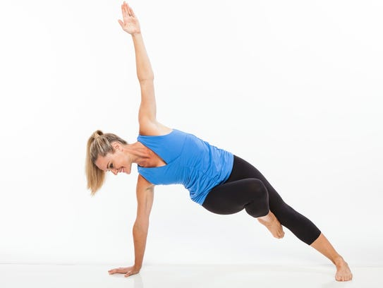 Jessica Smith demonstrates a side plank balance. Smith's