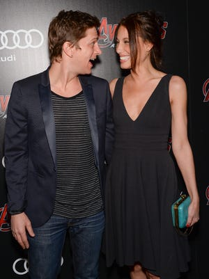 """Rob Thomas and wife Marisol Thomas attend a special screening of Marvel's """"Avengers: Age of Ultron"""" at the SVA Theatre on April, 28 in New York. The Rob Thomas show scheduled for Sunday, July 19 at Horseshoe Cincinnati's The Shoe has been canceled due to Marisol needing medical treatment."""