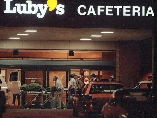 Officials remove bodies Oct. 16, 1991, from Luby's