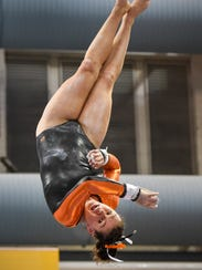 Tech's Taylor Terfehr competes on the uneven parallel