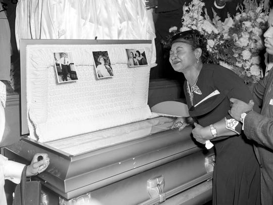 In this 1955 file photo, Mamie Till Mobley weeps at her son's funeral in Chicago.
