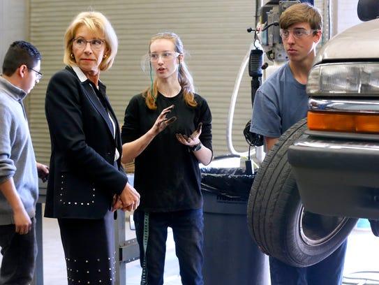 U.S. Secretary of Education Betsy DeVos tours the auto