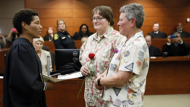 As more gay couples marry, such as Kathleen Tucker, right, and her partner Rebecca Roberts in Dallas, discussing retirement plans is more important than ever.