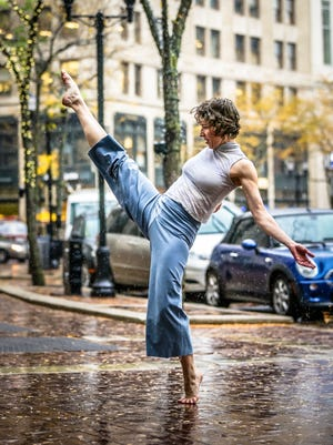 Site specific dancer, Stephanie Nugent, dances in front of the Hilbert Circle Theatre, Thursday October 2nd 2014. Nugent will perform with other dancers October 17 & 18, for the Art is Odd Places event, which will take place on and around City Market and Monument Circle.