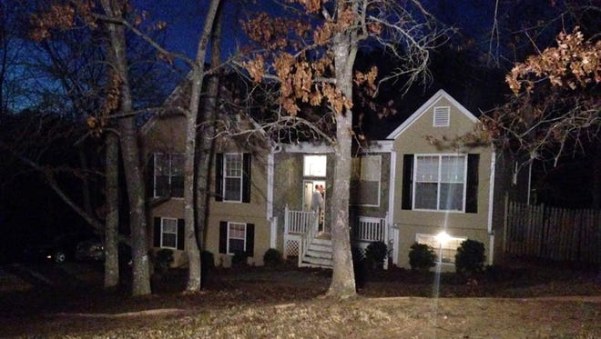 Five people, including three children, were killed Feb. 7, 2015, in and around this house in Douglasville, Ga.