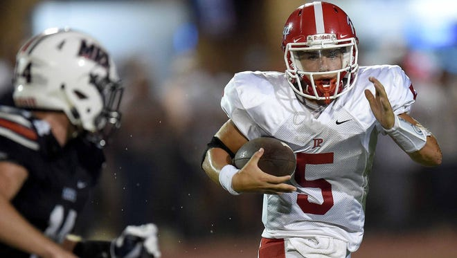 Prep quarterback Chance Lovertich (5) tries to turn the corner against MRA on Friday, September 16, 2016, at Madison-Ridgeland Academy in Madison, Miss.