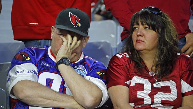Cardinals fans can't watch as their team loses 48-41 to the Saints, Sunday, Dec. 18, 2016 in Glendale, Ariz.
