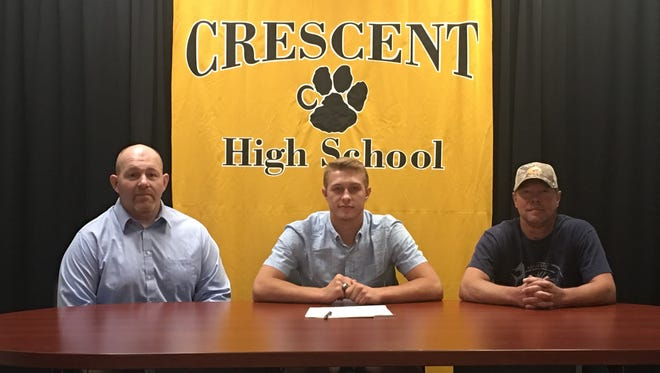 Crescent'a Alex Cartee signs to wrestle with Coker on Wednesday.