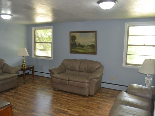 A remodeled living room that will be shared by occupants