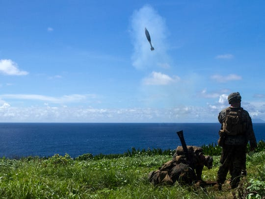 Marines firing a mortar in 2016 during training on the Mariana Islands.
