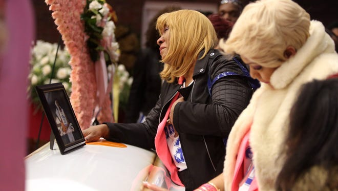 Jennifer Brown, left, and Yasmin Betty, aunts of Shamoya McKenzie, cry over the casket of the thirteen-old Mount Vernon resident during a service at the Macedonia Baptist Church in Mount Vernon Jan. 13, 2017. Hundreds filled the church to remember the eighth grader, who was killed by a stray bullet on New Year's Eve.