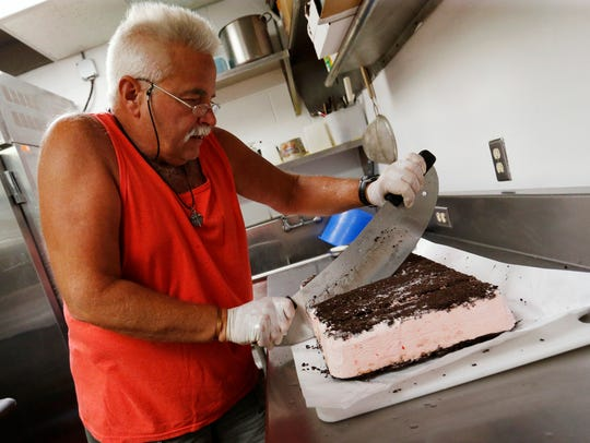 Steve Robertson slices up a slab of peppermint bars
