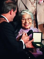 U.S. Vice President Al Gore, left, presents Rosa Parks