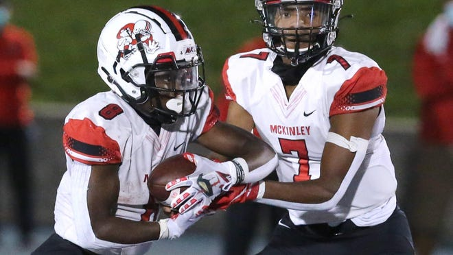 Elijah Wesley (7) of McKinley hands off to Brandon Foster (8) during their game at Lake on Friday, Sept. 11, 2020.
