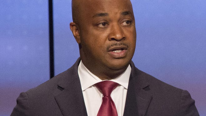 Kwanza Hall (left) answered a question while Vincent Fort listened during the Atlanta Police Foundation's Atlanta Mayoral debate hosted by WSB-TV at their studios in Atlanta on Sunday October 22nd, 2017. Crime and safety were the main topic of discussion during live debate. (Photo by Phil Skinner).