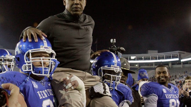 Kentucky players carried off coach Joker Phillips after beating Samford on Nov. 17, 2012.