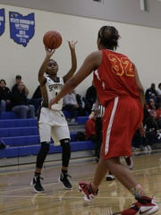 Roger Bacon's Jalyn Jackson (14) shoots the ball against Shroder's Alyssa McElroy on Dec. 29.