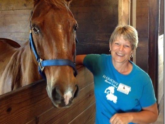 Sanna Scheuerman, shown here with Duke, has volunteered